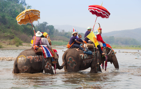 SUKHOTHAI - APRIL 7   Songkran Festival and Had Siew Elephant Ordains at Si Satchanalai from April 7 to 8, Riding on elephant and Thai Puan elephant ordination on April 7, 2014 in Sukhothai,Thailand  Stock Photo - 27442253