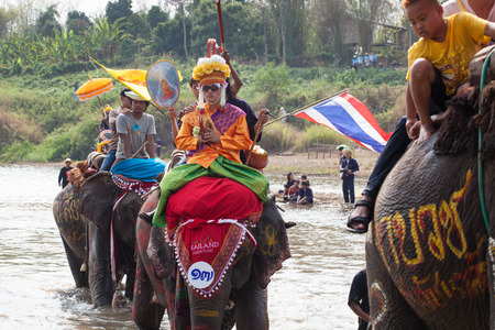 SUKHOTHAI - APRIL 7   Songkran Festival and Had Siew Elephant Ordains at Si Satchanalai from April 7 to 8, Riding on elephant and Thai Puan elephant ordination on April 7, 2014 in Sukhothai,Thailand  Stock Photo - 27442254