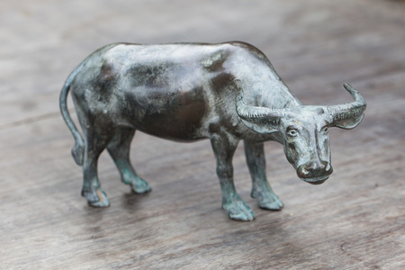 buffalo steel doll on wooden table. photo