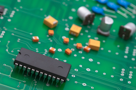 proto: Electronic part on green PCB. Stock Photo