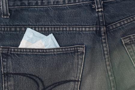 condones: Dos condones en jean. Foto de archivo