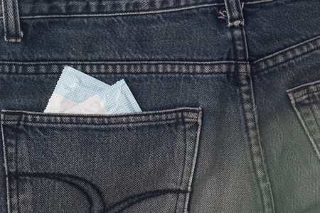 Two condoms in jean. photo