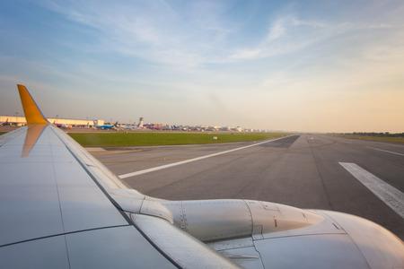 run way: aeroplane on run way with blue sky.