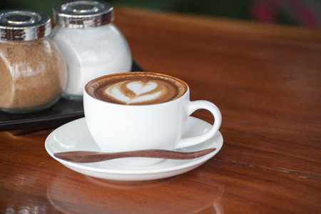 A cup of coffee latte.