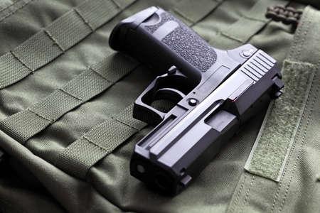 Weapon series. European 9mm semi-automatic pistol on a green background. Studio shot. Stok Fotoğraf
