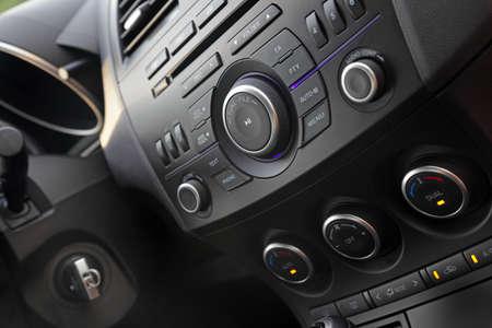 Modern car audio control close-up, shallow DOF