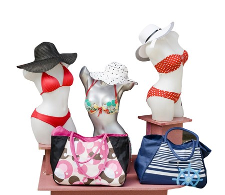 mannequins in bikinis and hats, beach bags