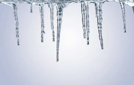 thawing: Thawing icicles isolated on blue