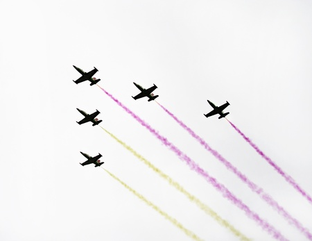 deformity: Five military planes flying and leaving multicolored stripes of smok