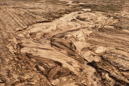 Soil erosion. The texture of sandy soil, which was destroyed by meltwater