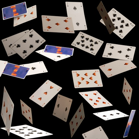 Flying cards on black background Editorial