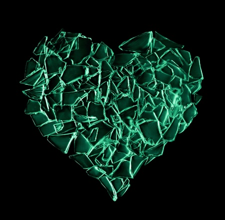broken green glass heart isolated on black background. complicated family life photo