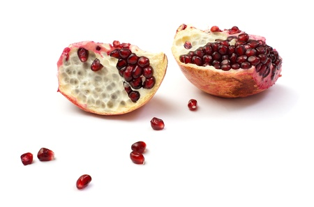 piece of pomegranate isolated on the white Stock Photo - 11501457