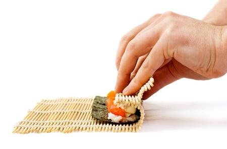 japanese foods: rolling sushi maki Stock Photo