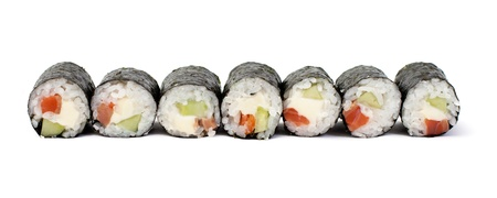 Close-up of maki sushi rolls with salmon and California cheese isolated on a white background