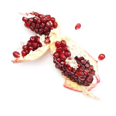 pomergranate: Sliced pomergranate isolated on white