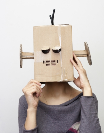 closed mouth: Robot Girl  Woman with a cardboard box on his head  Stock Photo