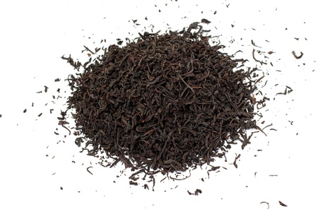 theine: Black tea loose dried tea leaves, isolated on the white background
