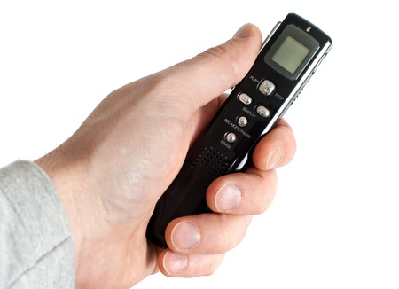 Male hand holding Audio Recorder