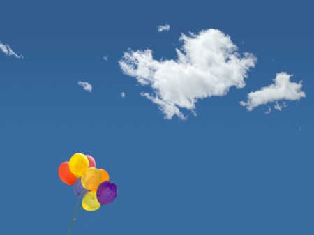 balloons and clouds in the blue sky
