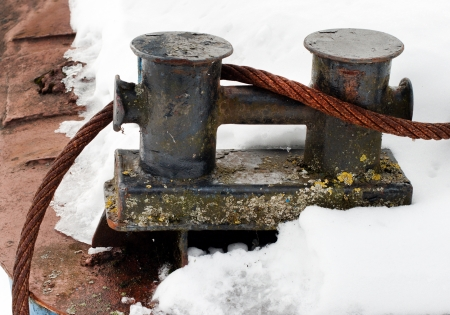 bollards: steel rope tied around the bollards  Stock Photo