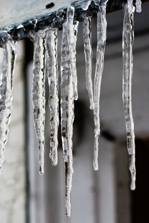 thawing: icicles which are hanging down from a roof Stock Photo