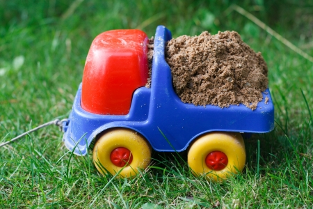 toy car with sand on the grass photo