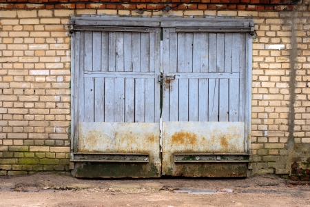 old garage gate in the brick wall Stock Photo - 22443807