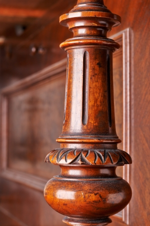 detail of an old German piano. A carved wooden decoration photo