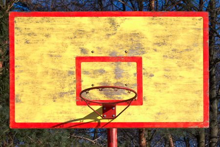 old basketball backboard and ring without grid photo