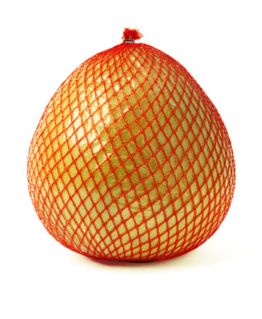 Pomelo fruit wrapped in red plastic reticle isolated on white background