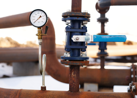 manometer: blue valve and manometer on rusty pipe
