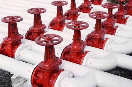 power equipment: white oil and gas pipe line and red valves