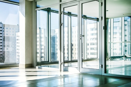 Office with glass wall and sunny weather Stock Photo