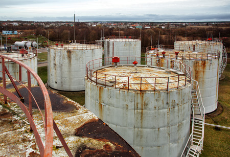 roofs of old  oil storage tanks with equipment