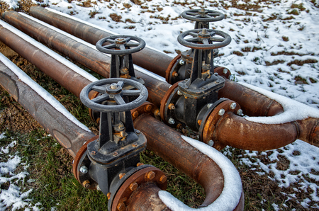 steel pipes and valves on industrial enterprise Stock Photo