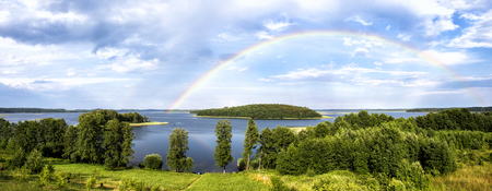 braslav: Rainbow in summer over the Stroust lake in Braslav region of Belarus. Panoramic image