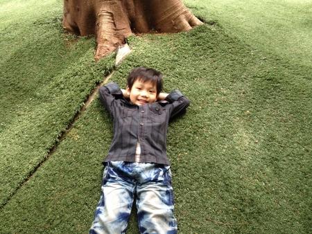 Asian kid relaxing in garden