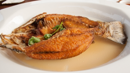 fried fish  on white plate