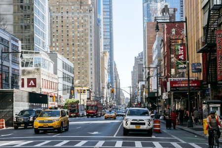 new automobile: New York, USA - September 20, 2015: People and taxi on the street of New York. Editorial