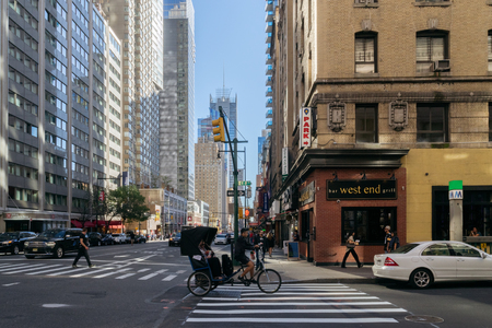 trishaw: New York, USA - September 20, 2015: Trishaw,  people and cars on the street of New York. Editorial
