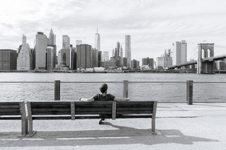 admire: New York, USA - September 21, 2015:  The man sits on the bench and admire of the downtown of New York. Editorial