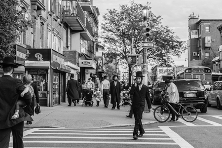 New York, USA - September 22, 2015: Jewish hassidic men cross the street.