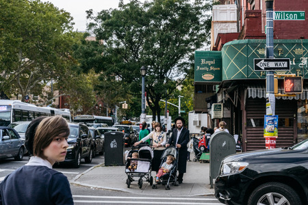 hassidic: New York, USA - September 22, 2015: Jewish hassidic pair cross the street. Editorial