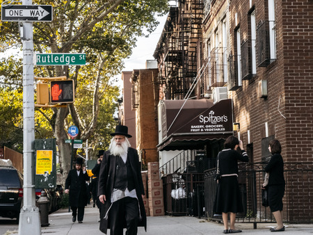 hassidic: New York, USA - September 22, 2015: Jewish hassidic man crosses the street.
