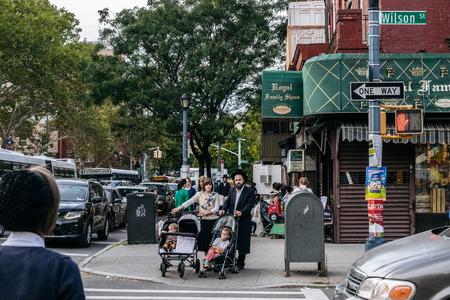 New York, USA - September 22, 2015: Jewish hassidic pair cross the street. Editorial