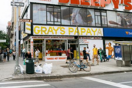 inexpensive: New York, USA - September 22, 2015: Grays Papaya is a hot dog restaurant. Grays Papaya is famous for its inexpensive, high-quality hot dogs.