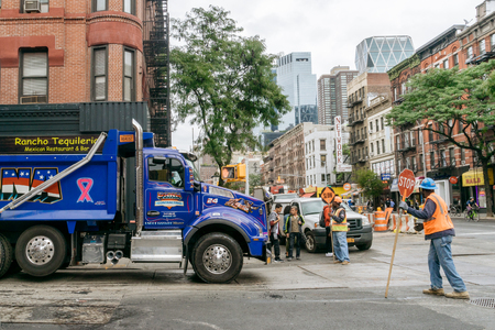 New York, USA - September 22, 2015:  Blue truck and road workers on the street of New York. Editorial