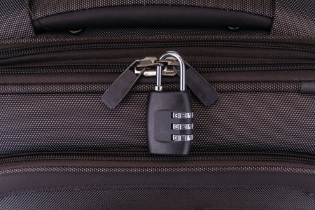 lock and key: Number combination padlock on the gray suitcase.