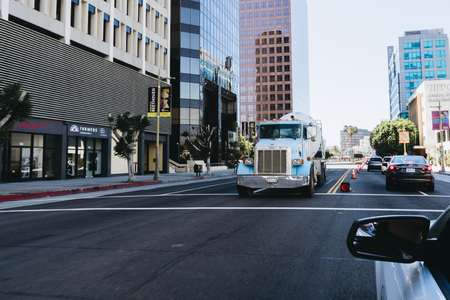 autotruck: Los Angeles, USA - September 26, 2015: Blue truck driving on Los Angeles street.
